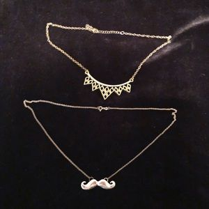 Mustache and qweenie necklaces